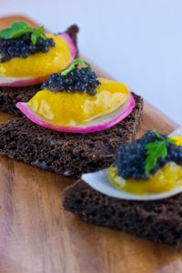 Amuse bouche - pumpernickel with egg middle and caviar