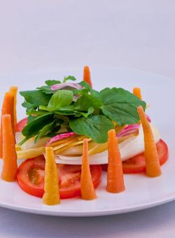 SALAD Roasted carrot & tomato salad with HV cow's milk cheese and wild cress