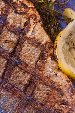 FISH bass - grill close up skin (a close-up of thyme and lemon stuffing, ...