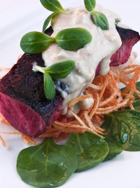 Charred Flat-Iron Steak with French Fried Potato Ribbons, Baby Spinach and Blue Cheese Sauce